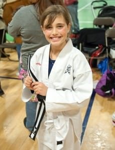 Action Karate successful black belt student.